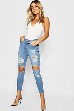 Se  Petite One Button Distressed Skinny Jeans ved Boohoo.com